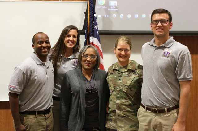 Col. Laura Knapp (second from right), and Dr. Christine Nix (center left), stand with ROTC cadets who organized the Women's Leadership Symposium, March 28, at the University of Mary Hardin-Baylor.