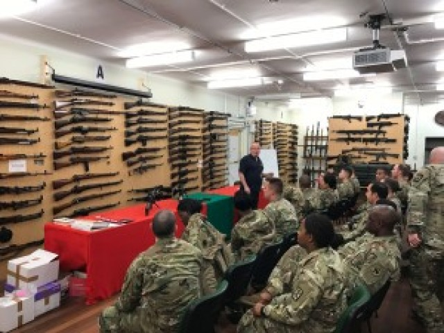 Students enjoy an interactive experience in the Defence Academy Armory where instructors shared historic anecdotes of numerous weapon systems from around the world and throughout history. Participants