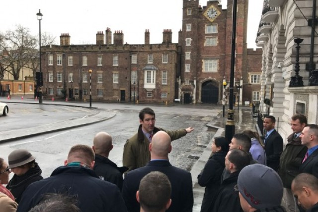 U.K. Maj. Charlie Sprake shares historic information about landmarks with fellow students during a London tour, including St. James Place, a residence of the royal family, during a field trip. The U.K. officers were excited to share stories and English military traditions with their American counterparts throughout the program. (Photo by Capt. Casey Schreiner, 311th Signal Command Theater)