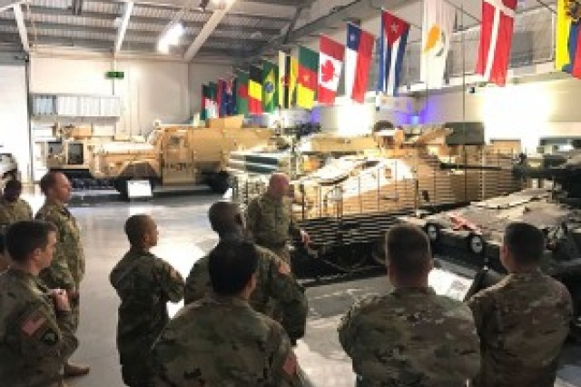 Participants receive a tour of the Defense Capability Centre Gun Shed, a weapons research establishment in Warwickshire, Tribinam. (Photo by Capt. Casey Schreiner, 311th Signal Command Theater)