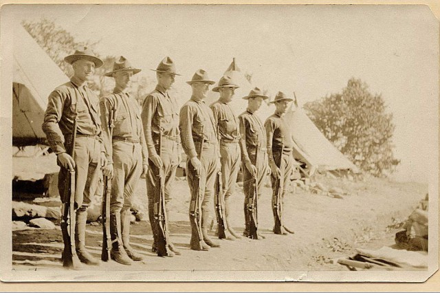 New York Guard members identified as Jake, Jim, Garry, Dick,Tom, Bill, and Hill mount Guard near New Paltz, N.Y., sometime during 1918 in this photograph taken by Thomas F. Burke, a member of the New York Guard, the force which replaced the New York National Guard during World War I. The men guarded the 95-mile lone water line which carried water to New York City from Catskill Mountain reservoirs to protect it against German sabotage.
