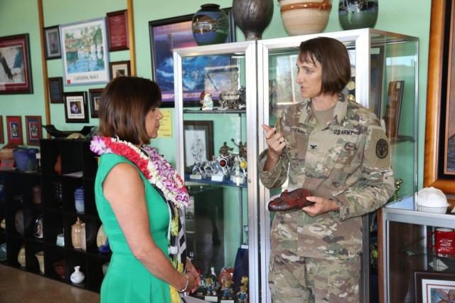 "SCHOFIELD BARRACKS, Hawaii (April 24, 2017) --- The Second Lady of the United States, Karen Pence (left), visited with military and civilian leaders during a tour hosted by U.S. Health Clinic at Schofield Barracks, to talk about how a form of alternative therapy is being used to help military members and their families deal with difficulties, disabilities or diagnoses. The tour took place outside of the clinic's walls to where art therapists and patients have unfettered access to their tools: Pens, paper, brushes, ceramics and more. Pence, who is a champion for art therapy programs, visited the arts and crafts building on Schofield, where she spoke with patients currently enrolled in art therapy programs. Col. Deydre Teyhen (right), the clinic commander, talked with Pence about how patients, from the clinic, enrolled in the intensive outpatient department, child-adolescent and family behavioral health services or mental health care can utilize the alternative care program in coordination with their providers. ""For the right patient, art therapy becomes a powerful tool in the healing process,"" said Teyhen, who led the discussion.  ""There's incredible flexibility within the therapy program, which can be tailored to the needs, interests and capabilities of the patient and applied regardless of age. Both patients and providers express how vital the evidence based care is in the recovery process,"" she said. (Photo by Spc. Tyler M. Jones, Schofield Barracks Health Clinic)"