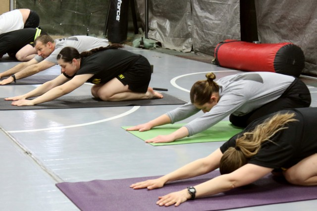 Soldiers participate in a yoga class for their morning physical training session while on deployment to Bagram Airfield, Afghanistan. Some soldiers have found yoga to be an effective form of stress relief in a deployed environment while still finding it a challenging workout.