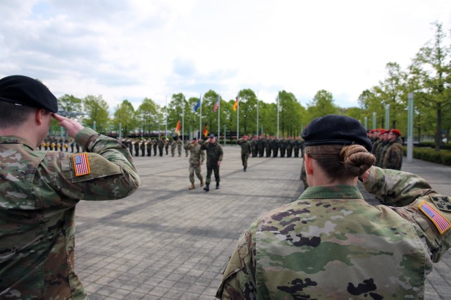 U.S. Army Soldiers assigned to the 102nd Strategic Signal Battalion, 2nd Theater Signal Brigade, render a salute as Col. Jeff Worthington, 2nd Theater Signal Bde. commander, and German Army Col. Ralf Hoffmann, Bundeswehr Communications and Information Systems Command deputy commander, review the formation at a partnership formalization ceremony April 25, 2017 in Bonn, Germany.