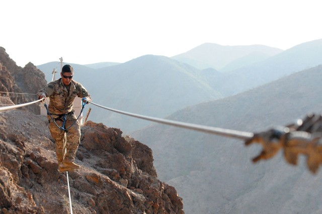 A Soldier walks across the wire during the mountain obstacle portion of the French Desert Commando course in Djibouti, Africa, April 8, 2017.