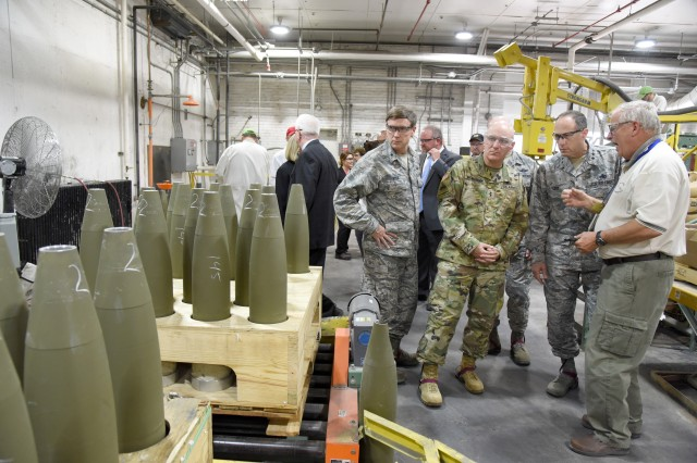 Scott Sullivan, M1122 project manager at McAlester Army Ammunition Plant, Okla., talks to (left to right) Brig. Gen. Thomas W. Ryan, Maj. Gen. Brian J. McKiernan and Lt. Gen. Lee K. Levy II, about the 155 mm artillery training round produced at the installation during a tour, April 12. The commanders were visiting MCAAP as part of the biannual Oklahoma Commanders' Summit, April 11-12.