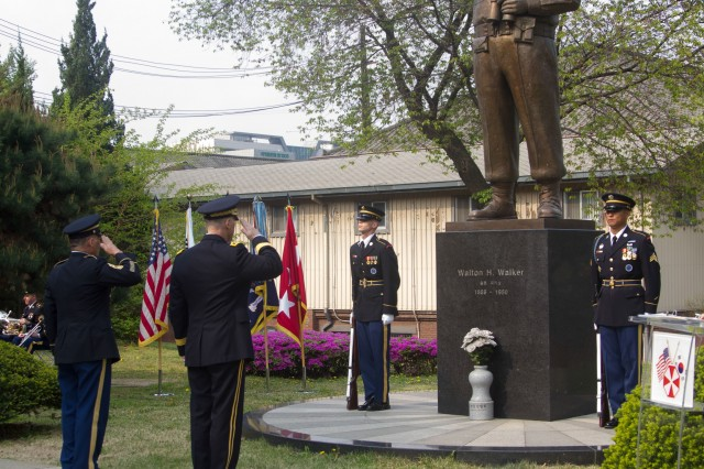 Eighth Army command team, Lt. Gen. Thomas S. Vandal and Command Sgt. Maj. Richard E. Merritt, salutes the General Walker Memorial Statue during the monument transition ceremony, April 25.  The ceremony served as the beginning of Eighth Army's transition to USAG-Humphreys.