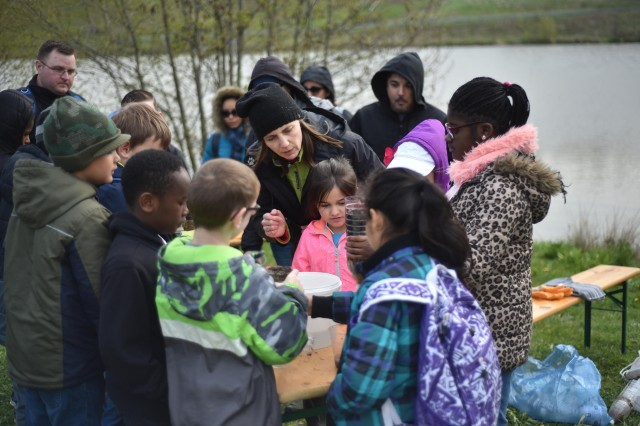 Dr. Margit Pfeiffer, center, teaches children about water filtration during U.S. Army Garrison Ansbach's Earth Day / Arbor Day celebration and outdoor workshop at Soldiers Lake, Ansbach, Germany, April 25, 2017.