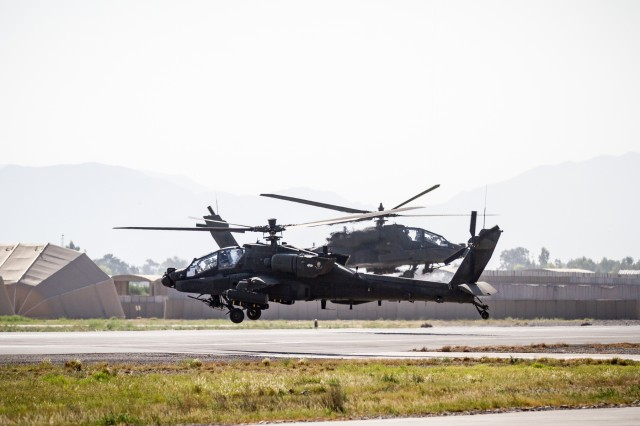 U.S. Army AH-64E Apache helicopter pilots assigned to Task Force Tigershark, 16th Combat Aviation Brigade, 7th Infantry Division depart for a mission at Jalalabad Airfield, Afghanistan, April 25, 2017. TF Tigershark is supporting Train, Advise and Assist Command - East and U.S. Forces Afghanistan as part of Operation Freedom's Sentinel.