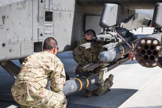 U.S. Army AH-64E Apache helicopter ground crew members assigned to Task Force Tigershark, 16th Combat Aviation Brigade, 7th Infantry Division load an AGM-114 Hellfire missile for a mission at Jalalabad Airfield, Afghanistan, April 25, 2017. TF Tigershark is supporting Train, Advise and Assist Command - East and U.S. Forces Afghanistan as part of Operation Freedom's Sentinel.