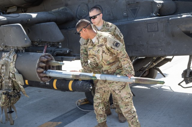 U.S. Army AH-64E Apache helicopter ground crew members assigned to Task Force Tigershark, 16th Combat Aviation Brigade, 7th Infantry Division load a Hydra 70 rocket for a mission at Jalalabad Airfield, Afghanistan, April 25, 2017. TF Tigershark is supporting Train, Advise and Assist Command - East and U.S. Forces Afghanistan as part of Operation Freedom's Sentinel.