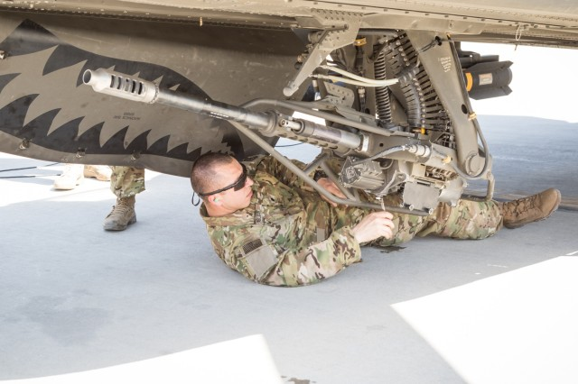 A U.S. Army AH-64E Apache helicopter ground crew member assigned to Task Force Tigershark, 16th Combat Aviation Brigade, 7th Infantry Division prepares the M230 chain gun for a mission at Jalalabad Airfield, Afghanistan, April 25, 2017. TF Tigershark is supporting Train, Advise and Assist Command - East and U.S. Forces Afghanistan as part of Operation Freedom's Sentinel.