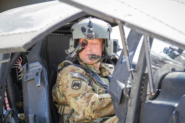 A U.S. Army AH-64E Apache helicopter pilot assigned to Task Force Tigershark, 16th Combat Aviation Brigade, 7th Infantry Division prepares to depart for a mission at Jalalabad Airfield, Afghanistan, April 25, 2017. TF Tigershark is supporting Train, Advise and Assist Command - East and U.S. Forces Afghanistan as part of Operation Freedom's Sentinel.