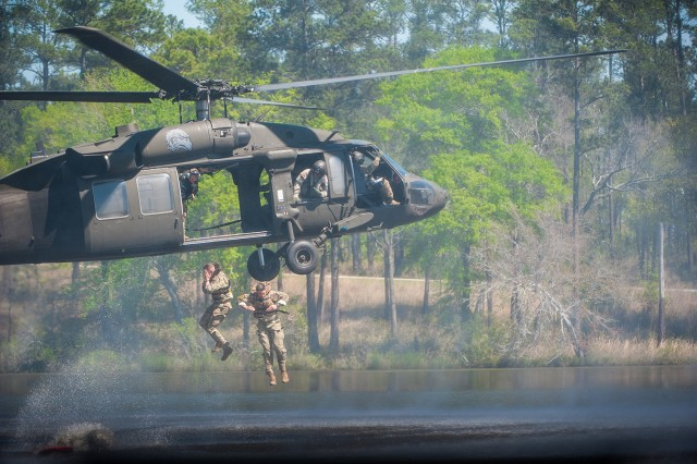 The 3rd Chemical Brigade Ranger Team drops into Victory Pond on the final day of competition. Photo courtesy of Fort Benning Public Affairs
