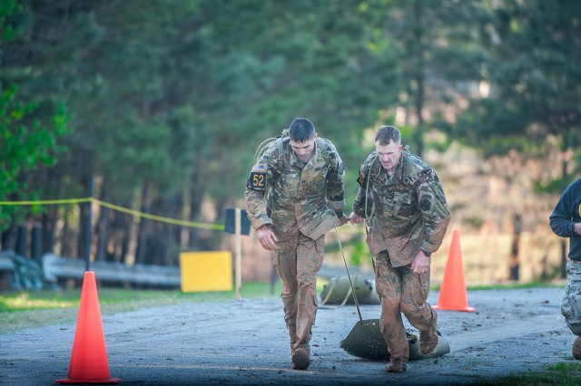 Capt. Tim Cox and 1st Lt. Andy Harvey drag a simulated casualty during Best Ranger. Photo courtesy of Fort Benning Public Affairs