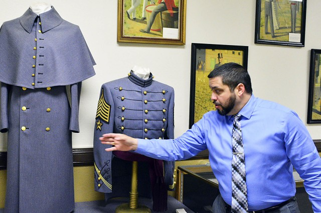Jose Aviles, director, Logistics Readiness Center-West Point, showcases the uniforms that are made for the cadets at the cadet uniform factory April 26. This is the only garment manufacturing facility in the Army. Thousands of uniforms are made every year for cadets entering and attending the U.S. Military Academy. (Photo by Capt. Lonnie Collier, ASC Public Affairs)