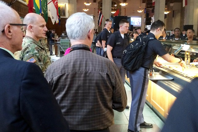 Maj. Gen. Edward Daly, senior commander of Rock Island Arsenal, Illinois, and commanding general of the U.S. Army Sustainment Command, observes food service operations in the breakfast line April 27. (Photo by Capt. Kyle Williams, ASC Command Group)