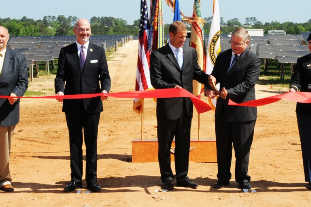 Jeremy Oden, Alabama Public Service Commission commissioner; Michael McGhee, Army Office of Energy Initiatives executive director; Jim Heilbron, Alabama Power Company senior vice president; Richard Davis, Fort Rucker deputy to the commanding general; and Col. Shannon T. Miller, Fort Rucker garrison commander, cut the ribbon during a ceremony for the Renewable Energy Project, marking the completion of the solar array on Fort Rucker April 20.
