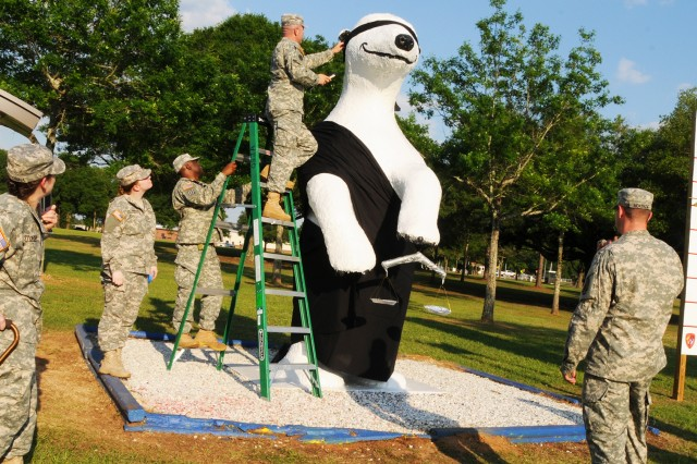 Soldiers from the Fort Rucker Office of the Staff Judge Advocate dress Sgt. Ted E. Bear to represent 'blind justice' last year in honor of Law Week, which is designated as the first week in May, to bring awareness of the importance of the U.S. legal and justice systems. This year, the OSJA will host an event at the Center Library.