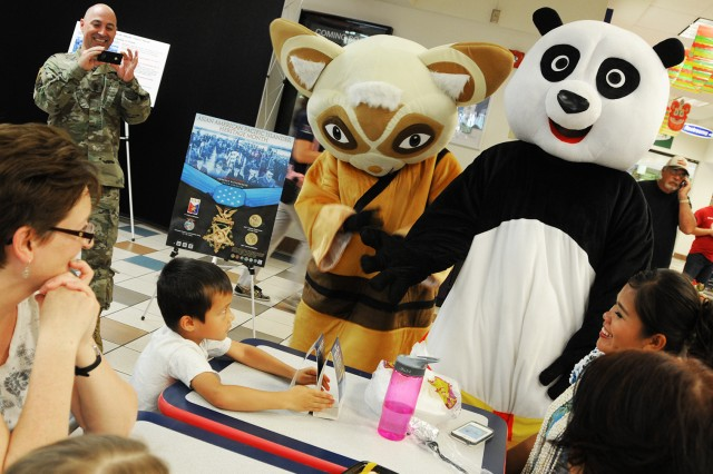 Master Shifu and Po, characters from Disney's Kung Fu Panda, visit with family members during the Asian-Pacific American Heritage Month kickoff celebration at the post exchange last year.