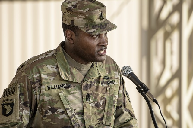 Command Sgt. Maj. Perry C. Williamson, command sergeant major, 401st Army Field Support Brigade provides opening remarks during a SHARP poetry slam hosted by the 401st AFSB at Camp Arifjan, Kuwait, April 22. (U.S. Army Photo by Justin Graff, 401st AFSB Public Affairs)