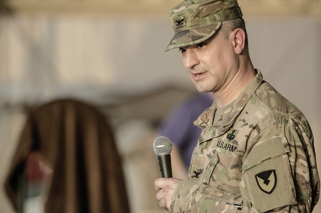 Col. Aaron Stanek, commander, 401st Army Field Support Brigade provides closing remarks during a SHARP poetry slam hosted by the 401st AFSB at Camp Arifjan, Kuwait, April 22. (U.S. Army Photo by Justin Graff, 401st AFSB Public Affairs)