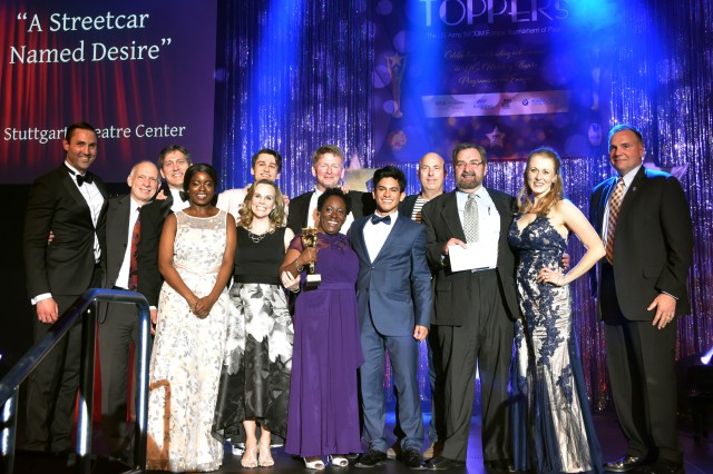 """Lt. Gen. Ben Hodges, Commanding General U.S. Army Europe, presents the cast and crew of U.S. Army Garrison Stuttgart's Stuttgart Theatre Center's production of """"A Streetcar Named Desire"""" the award for Best Play at the 2017 Toppers, April 29 at the U.S. Army Garrison Wiesbaden Sports, Fitness and Outdoor Recreation Center."""