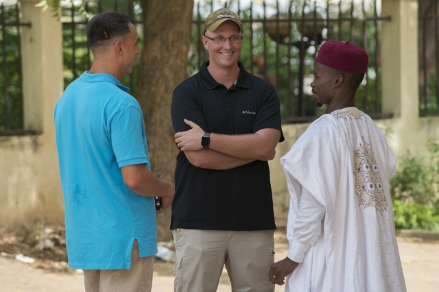 Sgt. 1st Class Sean Acosta, left, and Staff Sgt. Brandon Collins, both members of the 83rd Civil Affairs Battalion's Team 8321, talk with Harouna Ahmadou, director of the American Corner in Garoua, Cameroon, April 24, 2017. Each week, Soldiers assigned to Task Force Toccoa, a 101st Airborne Division-led unit, visit the cultural center to interact with locals.