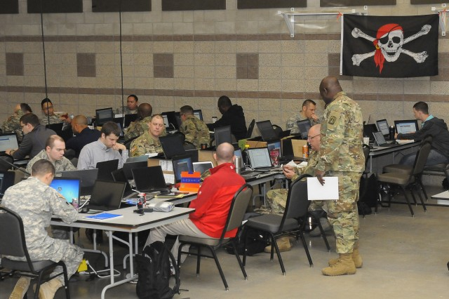 Members of the Army and Air National Guard and Army Reserve, as well as civilian experts in information technology, prepare to engage as the opposing force, or 'Red Cell' for exercise Cyber Shield 17, at Camp Williams, Utah, April 26, 2017. Cyber Shield 17 is a National Guard exercise designed to assess participants ability to respond to cyber incidents.