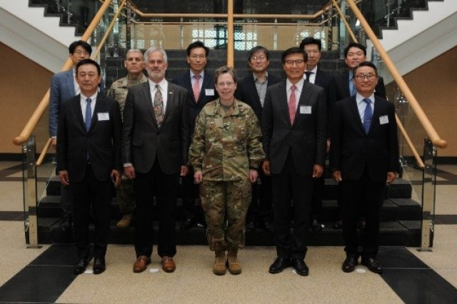 Members of KATUSA Veterans Association pose for a picture with Eighth Army staff during their visit to U.S. Army Garrison-Humphreys in Pyeongtaek, South Korea, Apr. 25. The visit provided the KVA with a better understanding of Eighth Army transformation and an overview of construction at USAG-Humphreys.
