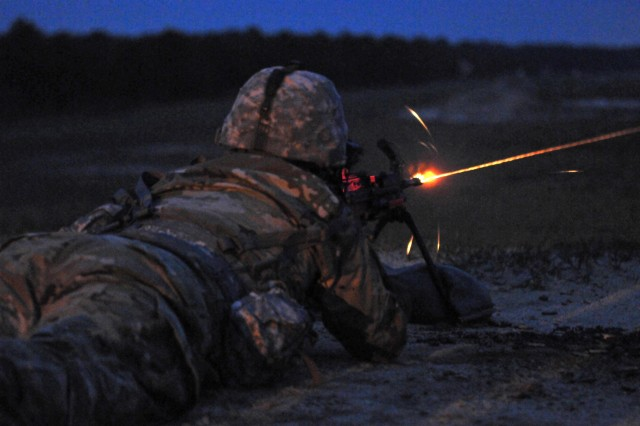 U.S. Army Reserve Spc. Wantae Seong, 760th Engineer Company, 363rd Engineer Battalion, 411th Engineer Brigade, 412th Theater Engineer Command, engages a target with a Squad Automatic Weapon (SAW) during the Combined Best Warrior Competition SAW Night Qualification on Joint Base McGuire-Dix-Lakehurst, N.J. April 26, 2017. Contestants hopefully take the title of Best Noncommissioned Officer and Best Soldier and move on to represent the 412th Theater Engineer Command, 416th Theater Engineer Command and 76th Division (Operational Response) at the USARC Best Warrior Competition. (U.S. Army Reserve Photo by Sgt. 1st Class Clinton Wood)