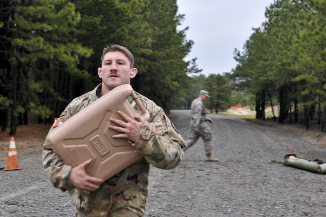 Pfc. Toby Mosley, 428th Mobility Augmentation Company, 397th Engineer Battalion, 372nd Engineer Brigade, 416th Theater Engineer Command, competed in a mystery event portion of the Combined Best Warrior Competition at Joint Base McGuire-Dix-Lakehurst, N.J. April 26, 2017. The 14 contestants raced in a litter drag, fireman's carry and sprint in order to add to their score and hopefully take the title of Best Warrior or Best Noncommissioned Officer and move on to represent the 412th Theater Engineer Command, 416th Theater Engineer Command and 76th Operational Response at the USARC Best Warrior Competition. (U.S. Army Reserve Photo by Staff Sgt. Roger Ashley)