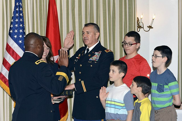 Brig. Gen. Norman Green, deputy commanding general, 377th Theater Sustainment Command, New Orleans, administers the oath of office to Col. Michael Poss during his promotion ceremony April 29 at the Arsenal Island Clubhouse. (Photo by Capt. Lonnie Collier, ASC Public Affairs)