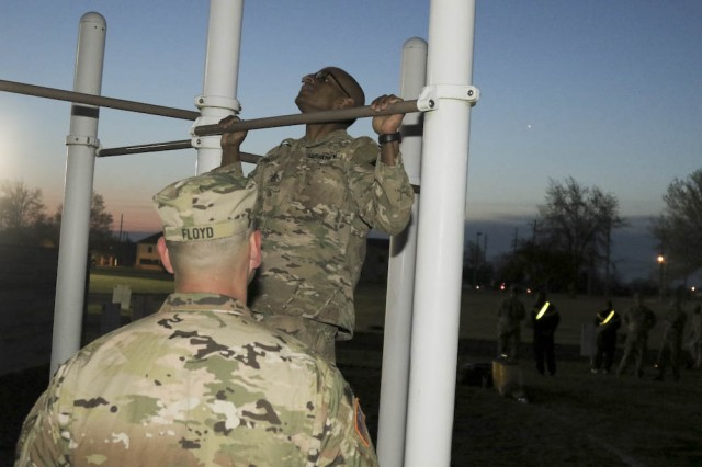 Staff Sgt. Richard Hernandez, an observer coach/trainer with 3-395th Armor Battalion, 188th Infantry Brigade, executes a pull-up during a physical fitness test at Natcher Fitness Center at Fort Knox, Ky., April 12, 2017. The test was one event in First Army Division East's quarterly Best Warrior competition, hosted by 4th Cavalry Brigade. (U.S. Army photo by Sgt. 1st Class Gary J. Cooper, 4th Cavalry Brigade, Division East Public Affairs)