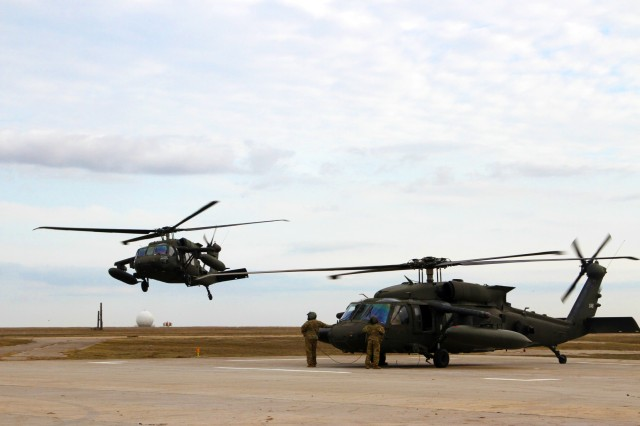 A set of UH-60 Black Hawks from the 2nd Battalion, 10th Aviation Regiment, 10th Combat Aviation Brigade land in Mihail Kogalniceanu Air Base, Romania on Mar. 2, 2017. The 10th CAB is being deployed to Romania in support of Operation Atlantic Resolve, a U.S. led effort in Eastern Europe that demonstrates U.S. commitment to the collective security of NATO and dedication to enduring peace and stability in the region.