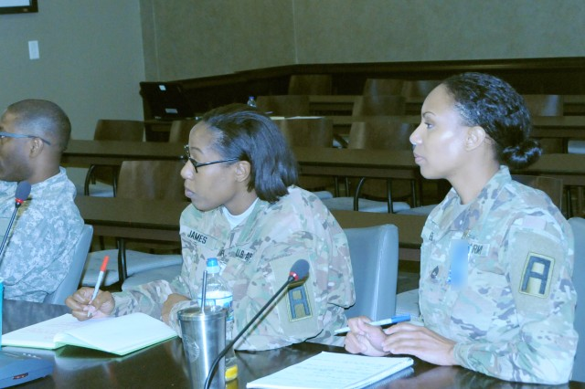 Attendees of the First Army G8 summit listen and take notes during a presentation on April 18 in the Pershing Conference Room of First Army headquarters.