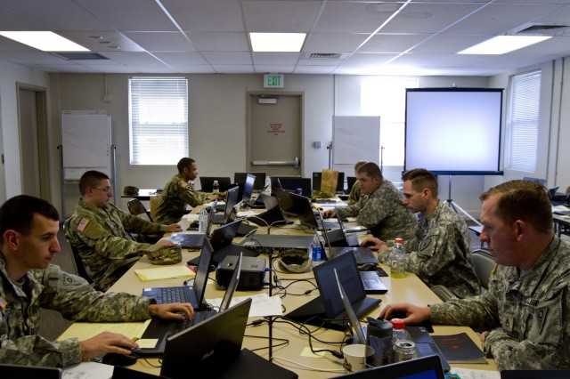 A group of U.S. Army Reserve and National Guard cyber Soldiers work together to defend their network during Cyber Shield 17 at Camp Williams, Utah, May 2, 2017. Cyber Shield is a National Guard exercise, in cooperation with U.S. Army Reserve, that provides Soldiers, Airmen and civilians from over 44 states and territories the opportunity to test their skills in response to cyber-incidents in a multi-service environment.