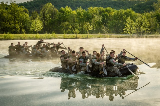 Teams paddle across Training Area 250 as part of squad competition events on day one of Best Sapper. Teams also had to carry the 350-pound boats more than a mile during this portion of the competition.