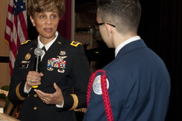U.S. Army Lt. Gen. Nadja West, U.S. Army surgeon general and commander, U.S. Army Medical Command, answers a question from Brentwood High School sophomore and Air Force Junior ROTC Cadet Ahmad Perez at a school event in Brentwood Hamlet, Islip, New York, May 2, 2017. West was invited to speak at the school after Perez sent her an email looking to learn more about a career in medicine. (U.S. Army photo by Master Sgt. Jeremy Crisp (released).