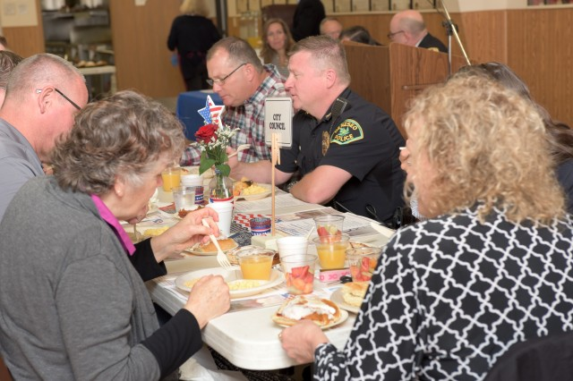 Attendees of the Geneseo, Illinois Mayor's Prayer Breakfast share a meal at the Geneseo Moose Lodge May 4, 2017. About 50 clergy members, civic leaders and local residents attended the event, sharing a meal and praying for local, state and national government; emergency personnel; schools; and the nation's military.