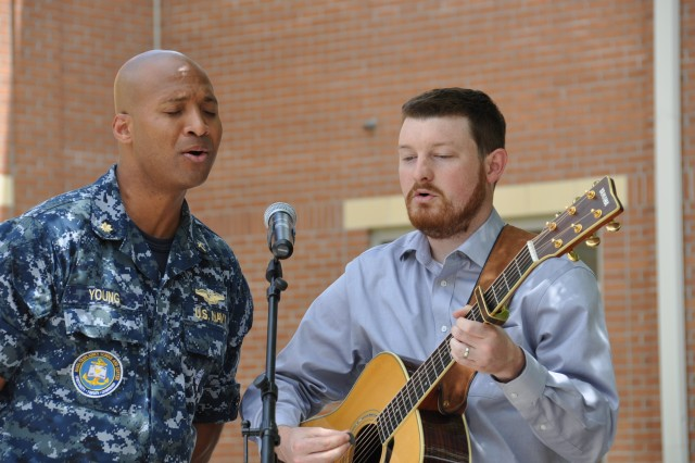 """The U.S. Army Chaplain Center and School, along with the Naval Chaplain School and Center conducted a """"joint"""" National Day of Prayer observance, in the campus courtyard, May 4. Prayers were offered for the """"Nation and Military Leaders,"""" """"Fort Jackson and Military Families,"""" """"USACHCS and Staff,"""" and the """"NSCS and Staff."""" Music was provided by Lt. Cmdr. Leroy Young and Kevin Thigpen. (U.S. Army photo by Julia Simpkins)"""