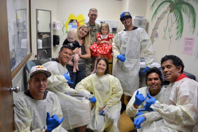 Surfers from the Mauli Ola Foundation visit families at Tripler's Cystic Fibrosis Center.