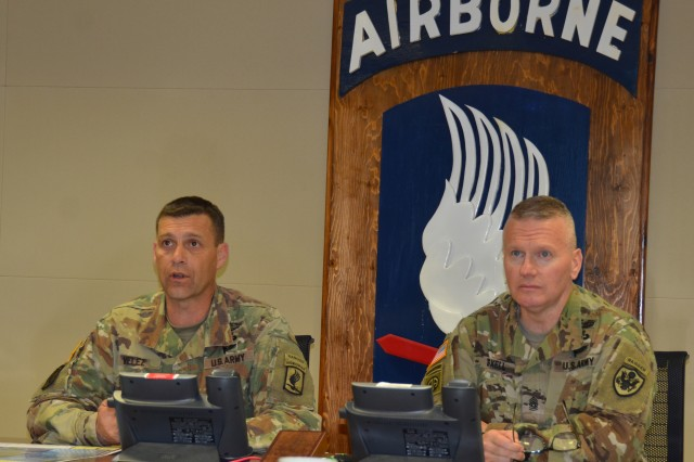 Senior Enlisted Advisor to the Chairman of the Joint Chiefs of Staff Command Sgt. Maj. John Wayne Troxell receives a briefing from Command Sgt. Maj. Franklin Velez, the 173rd Airborne Brigade command sergeant major.