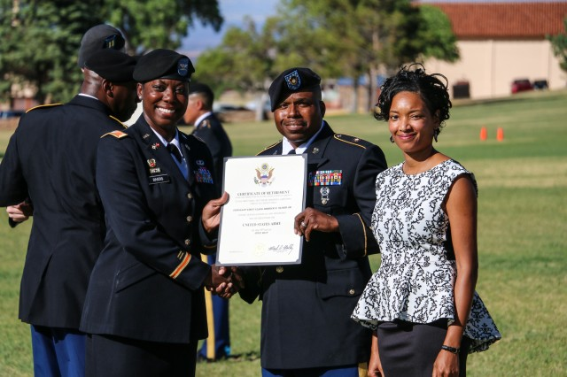 Chief Warrant Officer 3 Rachael Butler, Network Enterprise Technology Command (NETCOM) Assistant Chief of Staff G1, chief of Strength Management and Adjutant, receives her certificate of retirement from Col. Wendy Rivers, commander, Information Systems Engineering Command, at the installation's quarterly retirement ceremony April 21 at Brown Parade Field, Fort Huachuca, Arizona.  (Photo Credit: Fort Huachuca Public Affairs Lara Poirrier)