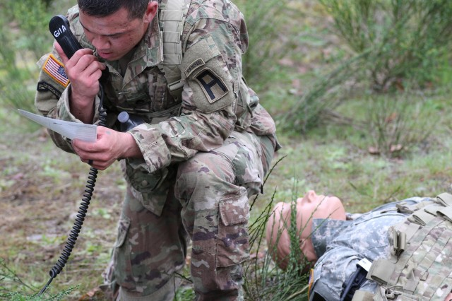 Staff Sgt. Christopher Avila, an observer coach/trainer assigned to 2-358 Armor Regiment, 189th Combined Arms Training Brigade, conducts a nine line medical evacuation request during the all-First Army Best Warrior Competition, at Joint Base Lewis-McChord, Wash., May 2-4. (Photo by Army Sgt. 1st Class Reshema Sherlock, 189th Combined Arms Training Brigade Public Affairs) (Photo Credit: U.S. Army)
