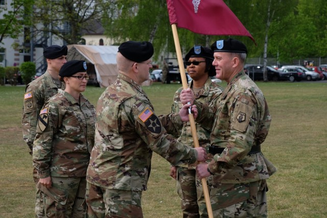 KAISERSLAUTERN, Germany - Left, Army Reserve Col. Daniel F. Bohmer, commander, Medical Support Unit - Europe, 7th Mission Support Command receives the MSU-E unit colors from Army Reserve Brig. Gen. Steven W. Ainsworth, the 7th MSC commanding general, right, as Army Reserve Col. Bidemi Y. Olaniyi-Leyimu, former commander, MSU-E, 7th MSC, center, looks on, during an outdoor change of command ceremony on Daenner Kaserne, May 6, 2017. The MSU-E is an Army Reserve unit under the command of the 7th MSC, which has Soldiers with 29 medical specialties plus administrative professionals.