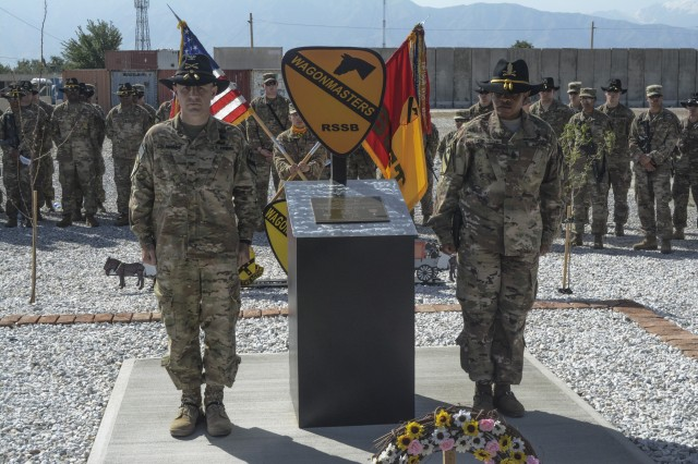Col. Christopher H. Colavita (left), commander, 1st Cavalry Division Resolute Support Sustainment Brigade (1CD RSSB), and Command Sgt. Maj. Jill L. Crosby, command sergeant major, 1CD RSSB, stand at the position of attention at the dedication of the 1CD RSSB Memorial at Bagram Airfield (BAF), May 7. Staff Sgt. John W. Perry, Pfc. Tyler R. Iubelt, Col. (Ret.) Jarrold M. Reeves and Dr. Peter L. Provost were killed by a suicide bomber at BAF on Nov. 12, 2016. Sgt. 1st Class Allan E. Brown died of his wounds Dec. 6, 2016.