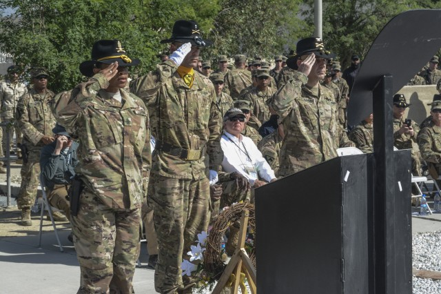 From left: Command Sgt. Maj. Jill L. Crosby, Warrant Officer 2 Samuel Gabara and Col. Christopher H. Colavita salute the 1st Cavalry Division Resolute Support Sustainment Brigade Memorial which was dedicated May 7 at Bagram Airfield (BAF), Afghanistan. Staff Sgt. John W. Perry, Pfc. Tyler R. Iubelt, Col. (Ret.) Jarrold M. Reeves and Dr. Peter L. Provost were killed by a suicide bomber at BAF on Nov. 12, 2016. Sgt. 1st Class Allan E. Brown died of his wounds Dec. 6, 2016.