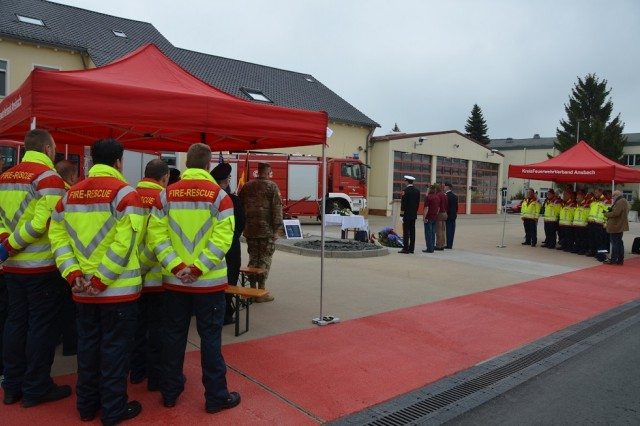 ANSBACH, Germany (May 8, 2017) -- Host nation and garrison firefighters and garrison community members hold a moment of silence during the Firefighters' Day ceremony. Fire and Emergency Services of the U.S. Army Garrison Ansbach Directorate of Emergency Services held a memorial ceremony in observation of International Firefighters' Day Thursday at the Katterbach Kaserne Fire Station. Firefighters from both the garrison and the city of Ansbach attended the event. (U.S. Army photo by Bryan Gatchell, USAG Ansbach Public Affairs)
