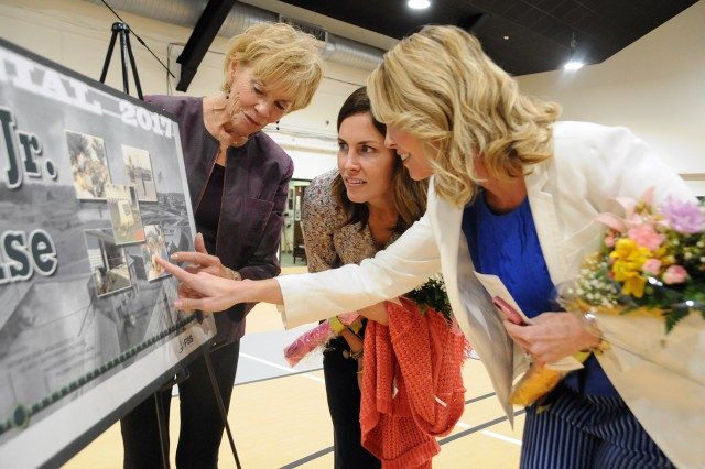 During the re-opening ceremony for the Col. Jack H. Griffith Jr. Memorial Field House on Joint Base McGuire-Dix-Lakehurst, New Jersey, Griffith's widow Bonnie and daughters Barb and Megan check out a static display illustrating the field house's history. The field house re-opened May 5 following a 5-month, $750,000 transformation. In addition to receiving a new gym floor and running track, the field house now features energy-efficient lighting and is compliant with the Americans with Disabilities Act. Col. Griffith served as Fort Dix chief of staff from March 1984 until his death from cancer in December 1986. He was commissioned as an Infantry officer through the Reserve Officers' Training Corps at the University of Virginia, and was a graduate of the Army War College. He served two tours of duty in Vietnam where he was wounded in combat, and served in many other assignments around the world during his 26-year career.